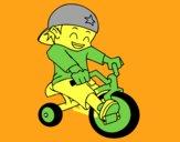 Niño en triciclo